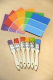 Paint Swatches and Paintbrushes stock photos