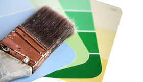 Paint Swatches with Used Paint Brush Royalty Free Stock Photography