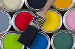 Paint - Tins of colorful emulsion paint Royalty Free Stock Photos