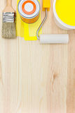 Paint tools and accessories. Brush, roller with paint can and color samples on wooden background royalty free stock photo