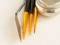 Paint tools - brush, spatula, canvas. Paint tools, brush, spatula, canvas and tin stock image
