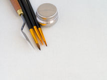 Paint tools - brush, spatula, steel oiler on canvas for art and. Creation royalty free stock photo