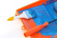 Paint tools. Closeup paint roller brush tools work paint blue color stock photos