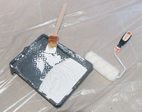 Paint tray with a paint brush and a roller Royalty Free Stock Photo