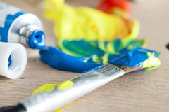 Paint tube and brush Royalty Free Stock Photo