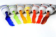Paint Tubes. With different colors spread over a white surface Royalty Free Stock Images