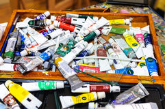 Paint tubes on artist table Royalty Free Stock Image