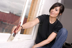 Woman Paints the Walls Window Sill Rainy Day Royalty Free Stock Photos
