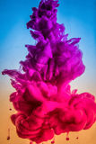 Paint in water, red, colorful, blue, green, yellow Royalty Free Stock Photography
