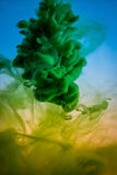 Paint in water, red, colorful, blue, green, yellow Royalty Free Stock Images