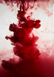 Paint in water, red, colorful, blue, green, yellow Stock Photos
