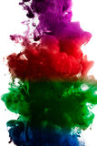 Paint in water, red, colorful, blue, green, yellow Stock Photo
