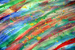 Paint watercolor vivid hues in rainbow colors, background Royalty Free Stock Photography