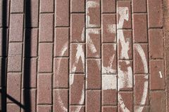 Paint bicycle sing on the ground royalty free stock photo