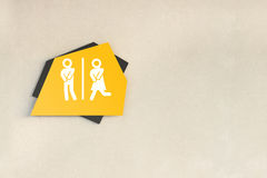 Paint wooden toilet sign. On gypsum board wall Royalty Free Stock Photo