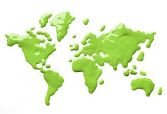 Paint the world green. Green paint splashes forming shapes of globe continents on white background isolated stock image