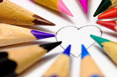 Paint your heart!. The heart contour, which can paint everyone on the taste with crayons royalty free stock photos