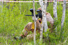 Paintball ambush in birch trees Stock Photos