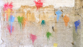 Paintball background. Colorful paintball splats on a concrete wall for your colors, abstract backgrounds and paintball copy Royalty Free Stock Photos