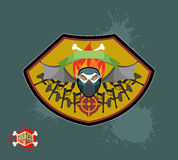 Paintball emblem club. Wings of fire and paintball guns. skull m Stock Photos