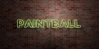 PAINTBALL - fluorescent Neon tube Sign on brickwork - Front view - 3D rendered royalty free stock picture Royalty Free Stock Photos