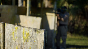 Paintball game action photo. Paintball game, arena, action photo. High resolution image Royalty Free Stock Image