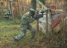 Paintball game playground arena with guns and mask training stock images
