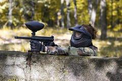 Paintball girl shooting enemies Stock Photography
