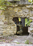 Paintball girl shooting from wrecked house Royalty Free Stock Photos