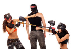 Paintball girls fight for the man Royalty Free Stock Image