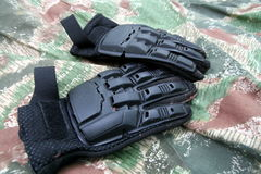 Paintball gloves. Black gloves for paintball players Stock Photography