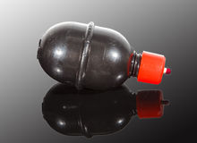 Paintball grenade on reflective surface. On grey background Royalty Free Stock Photo