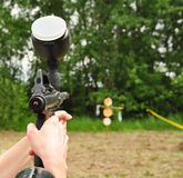 Paintball gun in action Royalty Free Stock Images