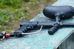Paintball gun lies under drizzle. Royalty Free Stock Photo