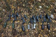Paintball Guns Lying on Autumn Leaves. royalty free stock photos