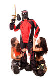 Paintball hero. Paintball player with girls around him Royalty Free Stock Photos