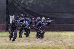 Paintball. Lancinating sportsmen. Royalty Free Stock Photo