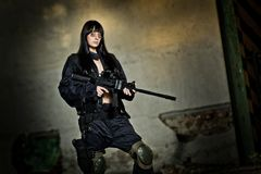 Paintball marker and girl Stock Image