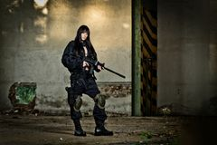 Paintball marker and girl Stock Images