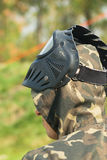 Paintball mask. A teen in camouflage and mask ready for paintball Stock Photography
