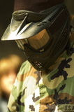 Paintball Mask. A teenager dressed in camouflage on a paintball course Stock Photos