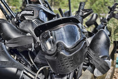 Paintball masks and markers Stock Photos