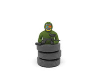 Paintball. Er in protective mask with spots of paint stands in a pile of tires Royalty Free Stock Image