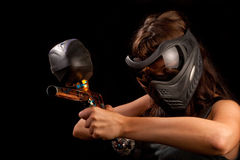 Paintball player. Image of a paintball player in protective helmet aiming the target Royalty Free Stock Photo