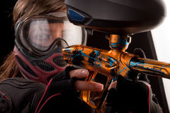 Paintball player. Image of a paintball player in protective helmet aiming the target Stock Photo