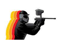 Paintball player. In black uniform with marker gun Stock Photography