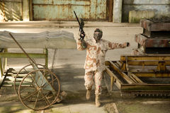 Paintball player in abandoned building Royalty Free Stock Photos