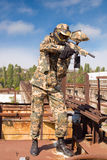 Paintball player in abandoned place. Paintball player in rusty abandoned place royalty free stock photography