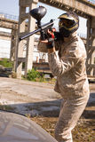 Paintball player in abandoned place. Paintball player in old abandoned place royalty free stock images