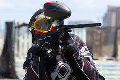 Paintball player in action stock image